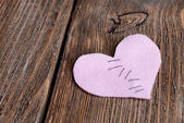 Broken heart and thread on wooden background — Stock Photo