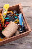 Wooden box with different tools — Stock Photo