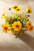 Beautiful wild flowers on table — Stock Photo