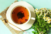 Cup of fresh herbal tea on table — 图库照片