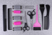Professional hairdresser tools  on gray background — Стоковое фото