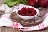 Grated beetroots in bowl on table close-up — Stock Photo