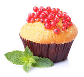 Tasty muffin with red currant isolated on white — Stock Photo