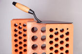 Metal tool for building and bricks on bright background — Stock Photo