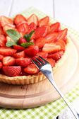 Strawberry tart on wooden tray, on color wooden background — Stok fotoğraf