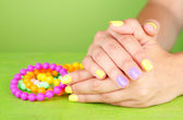 Female hand with stylish colorful nails — Stock Photo