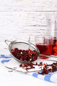 Hibiscus dried tea and flower on wooden background — Foto de Stock