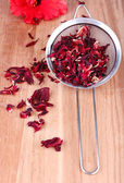 Hibiscus dried tea on wooden background — ストック写真