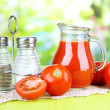 Tomato juice in glass jug — Stock Photo #49095857