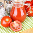 Tomato juice in glass jug — Stock Photo #49095861