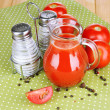 Tomato juice in glass jug — Stock Photo #49095863
