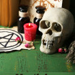 Composition with skull,old book, magic potions, candle and dry herbs — Stock Photo #49096283