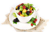 Fruit salad in cup on napkin — Stock Photo