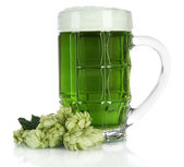 Glass of green beer and hops — Stock Photo