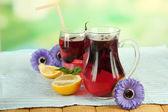 Red basil lemonade in jug and glass — Stock Photo