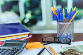 Office supplies with documents and money on table — Stock Photo