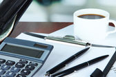 Office supplies with wallet and cup of coffee — Stock Photo