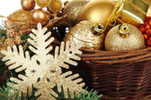 Christmas decorations in basket — Stock Photo