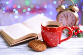 Composition of book with cup of coffee — Stock Photo