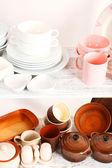 Different tableware on shelf — 图库照片