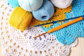 Colorful clews, napkin and crochet hooks — Stock Photo