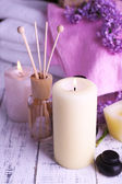 Composition with spa treatment, towels and lilac flowers — Stock Photo