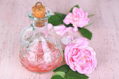 Rose oil in bottle — Stok fotoğraf