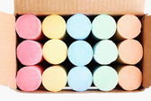 Color chalks in paper box — Stock Photo