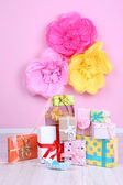 Many birthday gifts in room — Foto Stock