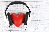 Headphones and heart — Stock Photo