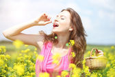 Woman holding basket with cherries in field — Foto Stock