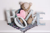 Decorative letters forming word HOME with teddy bear — Stock Photo