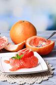 Ripe peeled grapefruits on plate — Stockfoto
