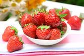 Ripe sweet strawberries in bowl — Stockfoto