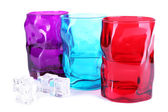 Colorful glasses and ice cubes — Stock Photo