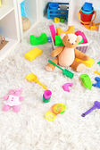 Colorful toys on fluffy carpet in children room — Stock Photo