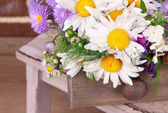 Beautiful flowers in crate — Stock Photo