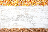 Cereals on wooden background — Foto Stock