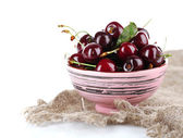 Sweet cherries in color bowl — Stockfoto