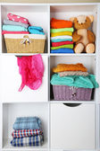Clothes on shelves — Stock Photo