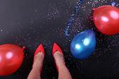 Legs with confetti — Stock Photo