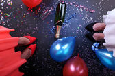 Legs with balloons and confetti — Stock Photo