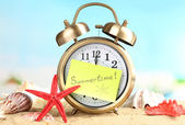 Clock on sand — Stock Photo