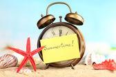 Clock on sand — Stock Photo