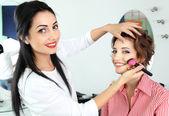Stylist doing makeup beautiful girl — Stock Photo