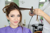 Woman hairdresser do hairstyle girl — Stock Photo