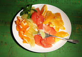 Citrus fruits on plate — Stock Photo