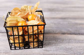 Physalis fruits in basket — Stock Photo
