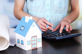 Counting property prices — Stockfoto
