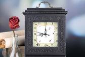 Still life with retro clock — Stock Photo